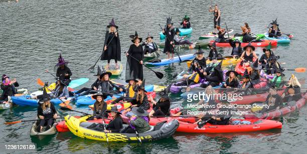 Ladies of OC Beaches bewitch the Dana Point Harbor as they have some pre-Halloween fun on Saturday, October 23, 2021. The park their brooms er,...