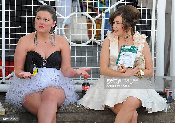 Ladies prepare to watch the action on Ladies' Day on the second day of the Grand National horse racing meeting at Aintree Racecourse in Liverpool...
