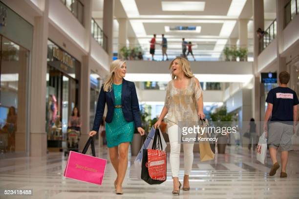 ladies shopping at macy's-mall of america, bloomington, minnesota - mall of america stock pictures, royalty-free photos & images