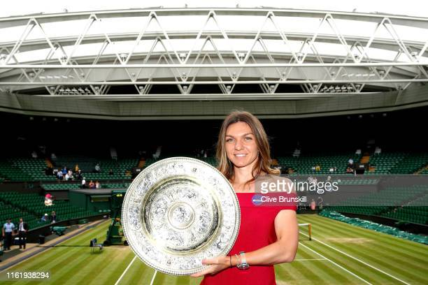 Ladies' Singles Champion, Simona Halep of Romania poses for a photo with the trophy in the Royal Box on centre court during Day thirteen of The...