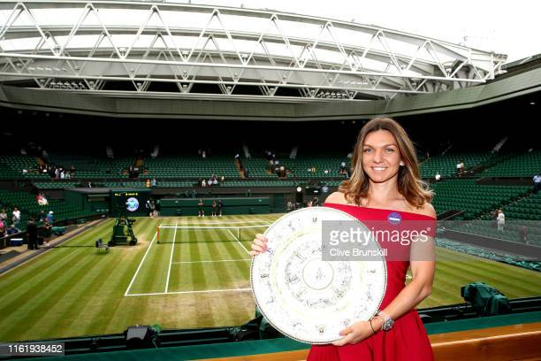 Ladies' Singles Champion Simona Halep of Romania poses for a photo with the trophy in the Royal Box on centre court during Day thirteen of The...