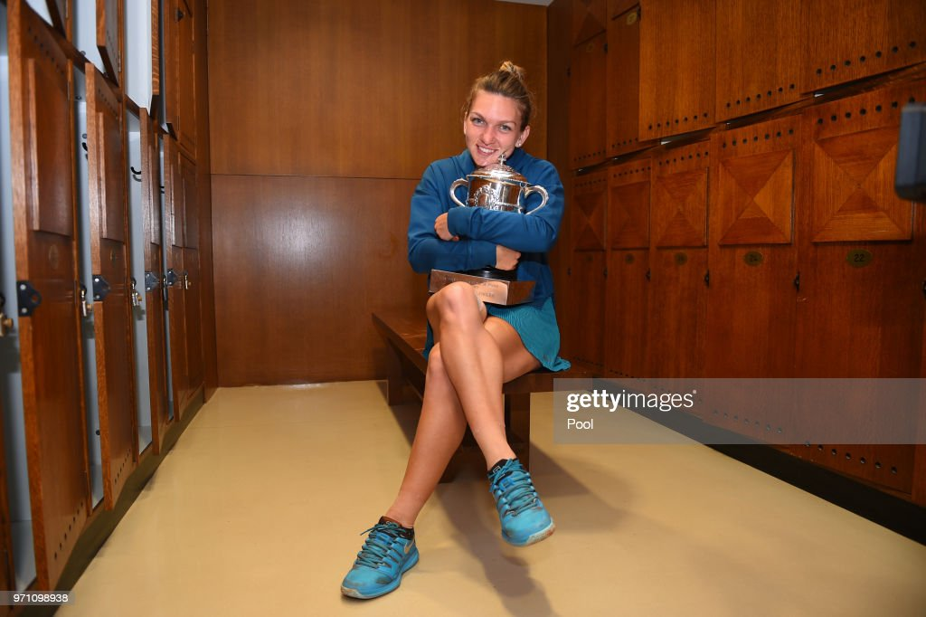 Ladies singles winner Simona Halep of Romania celebrates in the dressing room following her victory in the ladies singles final against Sloane Stephens of The United States on day fourteen of the 2018 French Open at Roland Garros on June 9, 2018 in Paris, France.