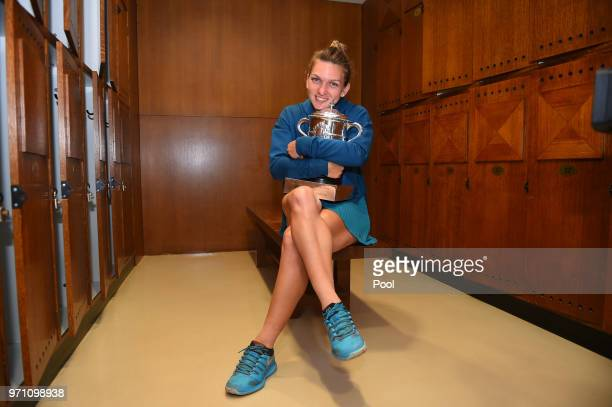 Ladies singles winner Simona Halep of Romania celebrates in the dressing room following her victory in the ladies singles final against Sloane...