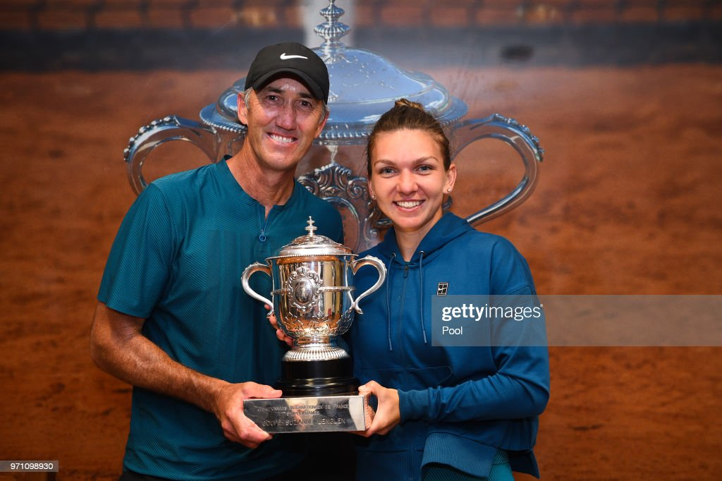 Ladies singles winner Simona Halep of Romania celebrates with her coach Darren Cahill in the dressing room following her victory in the ladies singles final against Sloane Stephens of The United States on day fourteen of the 2018 French Open at Roland Garros on June 9, 2018 in Paris, France.