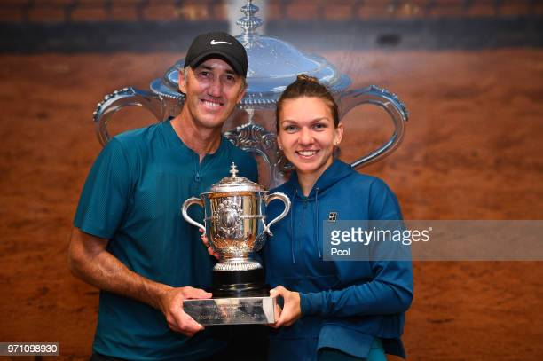 Ladies singles winner Simona Halep of Romania celebrates with her coach Darren Cahill in the dressing room following her victory in the ladies...