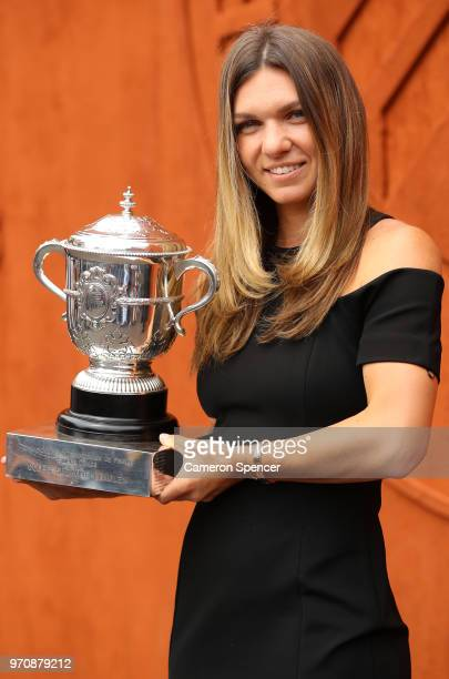 Ladies singles winner Simona Halep of Romania poses with the Suzanne Lenglen trophy during day fifteen of the 2018 French Open at Roland Garros on...