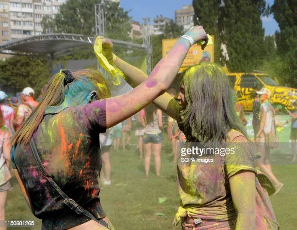 Ladies sprinkle coloured powder to each other during a Festival The traditional annual festival of India is gaining popularity in Ukraine At the end...