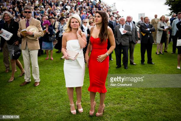 Ladies watch the action on day three of the Qatar Goodwood Festival at Goodwood racecourse on August 3 2017 in Chichester England