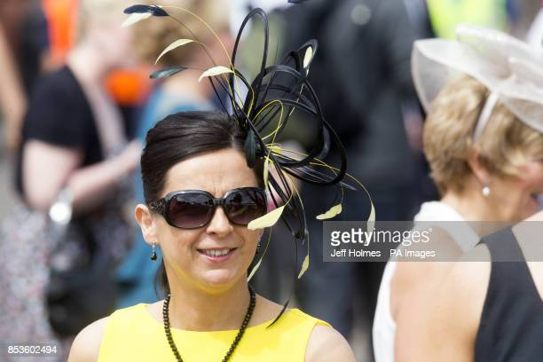 Ladies wear fancy hats during Stobo Castle Ladies Day at Musselburgh Racecourse East Lothian