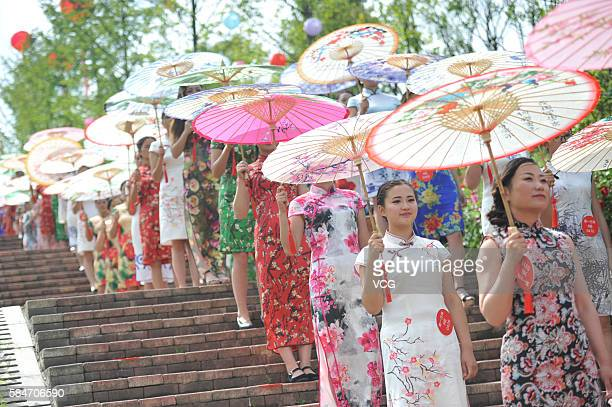 Ladies wearing cheongsams walk around Minghu Wetland Park on July 29 2016 in Liupanshui Guizhou Province of China Nearly 3000 ladies from all corners...