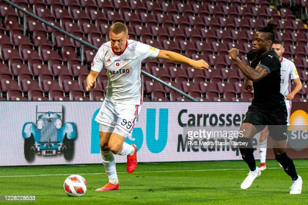 Ladislav Almasi of MFK Ruzomberok battles for the ball with Arial Mendy of Servette FC during the UEFA Europa League qualification match between...