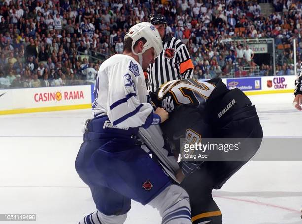 Ladislav Kohn of the Toronto Maple Leafs skates against Tyler Wright of the Pittsburgh Penguins during the 1999 Quarter Finals of the NHL playoff...