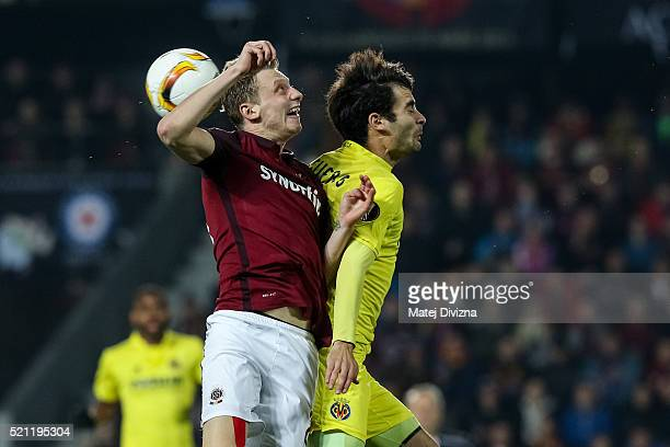 Ladislav Krejci of Sparta Prague competes for the ball with Manu Trigueros of Villareal during the UEFA Europa League Quarter Final second leg match...
