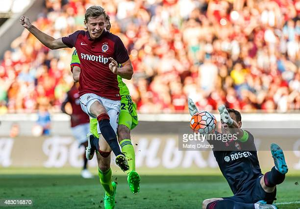 Ladislav Krejci of Sparta Prague scores the opening goal past Igor Akinfeev goalkeeper of CSKA Moscow during the UEFA Champions League Third...