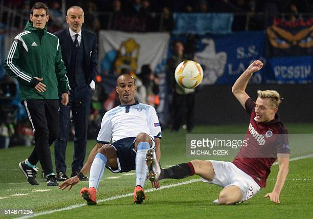 Ladislav Krejci of Sparta Praha vies for a ball with Abdoulay Konko of SS Lazio during the UEFA Europa League Round of 16 firstleg football match...