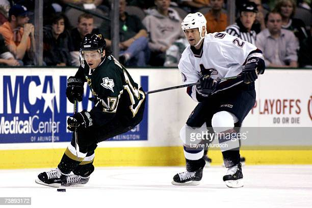 Ladislav Nagy of the Dallas Stars works the puck against Bryan Smolinski of the Vancouver Canucks during the 1st period of game three of the 2007 NHL...