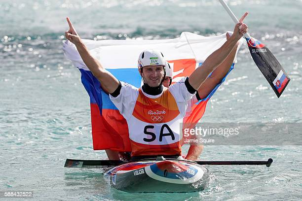 Ladislav Skantar and Peter Skantar of Slovakia celebrate winning gold medal after the Men's Canoe Double Final on Day 6 of the Rio 2016 Olympics at...