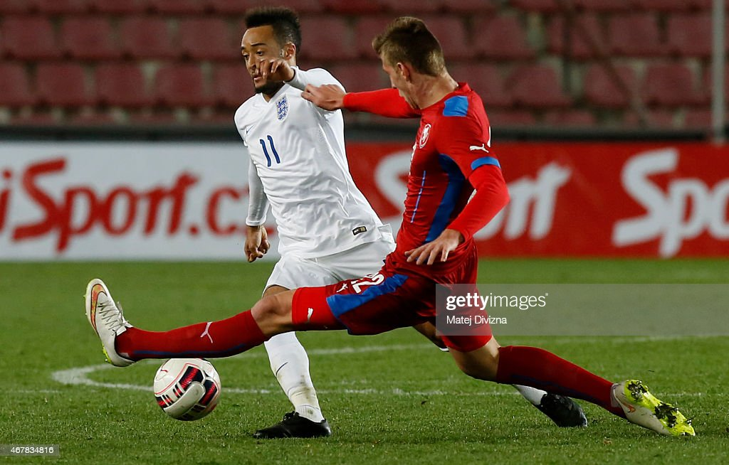 Ladislav Takacs of Czech Republic (R) battles for the ball with Nathan Redmond of England (L) during the international friendly match between U21 Czech Republic and U21 England at Letna Stadium on March 27, 2015 in Prague, Czech Republic.