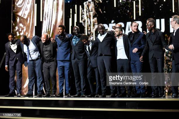 Ladj Ly and members of the cast and crew of Les Miserables on stage during the Cesar Film Awards 2020 Ceremony At Salle Pleyel In Paris on February...