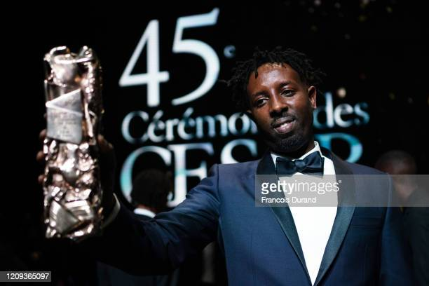 Ladj Ly poses with the Cesar for Best Film for 'Les Misérables during the Cesar Film Awards 2020 Ceremony at Salle Pleyel on February 28 2020 in...