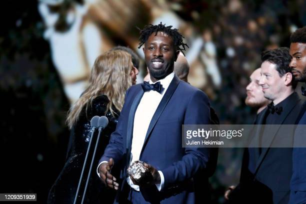 Ladj Ly receives the best film award for 'Les Misérables' on stage during the Cesar Film Awards 2020 Ceremony At Salle Pleyel In Paris on February...