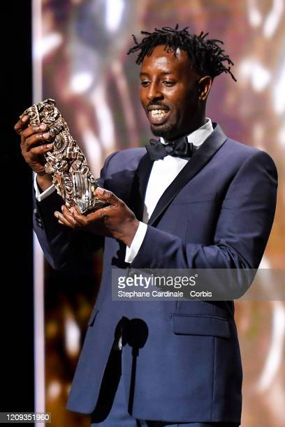Ladj Ly who receives the César people's choice award for 'Les Misérables' on stage during the Cesar Film Awards 2020 Ceremony At Salle Pleyel In...
