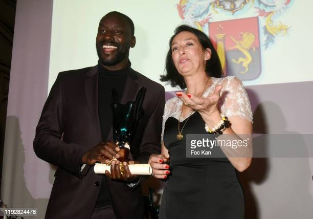 Ladji Doucouré and Tania de Bourbon Parme attend the 43rd Best Awards Edition At Cercle Interallie on December 08 2019 in Paris France