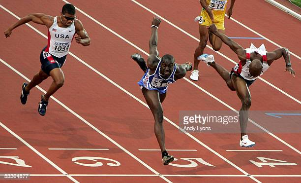 Ladji Doucoure of France crosses the finish line during the men's 110 Metres Hurdles final at the 10th IAAF World Athletics Championships on August...