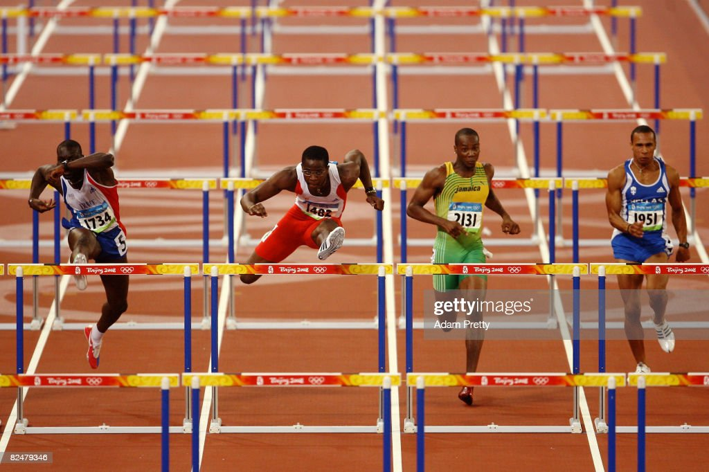Ladji Doucoure of France, Dayron Robles of Cuba and Richard Phillips of Jamaica compete men's 110m hurdles during the track and field athletics event at the National Stadium during Day 12 of the Beijing 2008 Olympic Games on August 20, 2008 in Beijing, China.