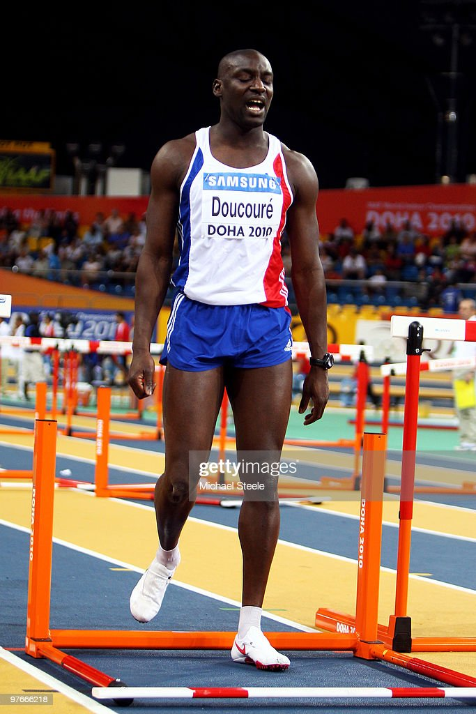Ladji Doucoure rof France reacts after knocking down a hurdle competes in the mens 60m hurdle heats during Day 1 of the IAAF World Indoor Championships at the Aspire Dome on March 12, 2010 in Doha, Qatar.
