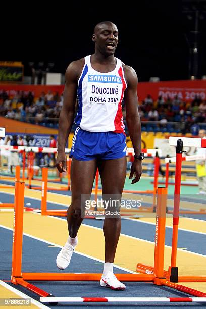 Ladji Doucoure rof France reacts after knocking down a hurdle competes in the mens 60m hurdle heats during Day 1 of the IAAF World Indoor...