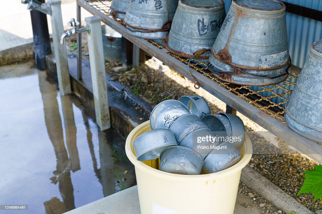 Ladle and bucket used to visit the grave : Stock Photo