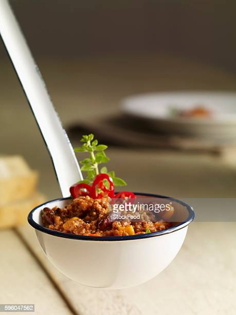 a ladle full of chilli con carne - indian corn stock photos and pictures