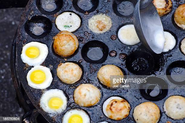 cooking quail eggs in yangon, myanmar (burma) - rangoon stockfoto's en -beelden