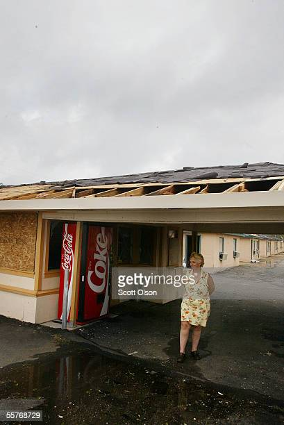 Ladonna Benoit looks out from the damaged Motel Five where she rode out Hurricane Rita September 25 2005 in Lake Charles Louisiana Benoit was...