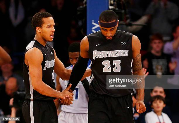 LaDontae Henton and Josh Fortune of the Providence Friars celebrate in the second half against the Creighton Bluejays during the Championship game of...