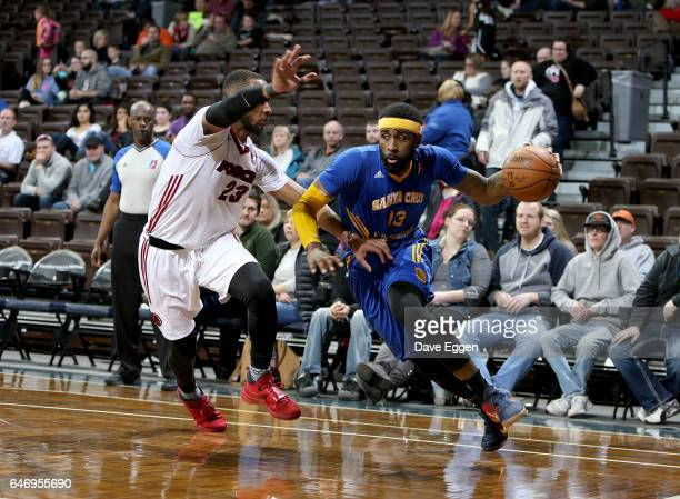 LaDontae Henton from the Santa Cruz Warriors drives against Jabril Trawick from the Sioux Falls Skyforce at the Sanford Pentagon March 1 2017 in...