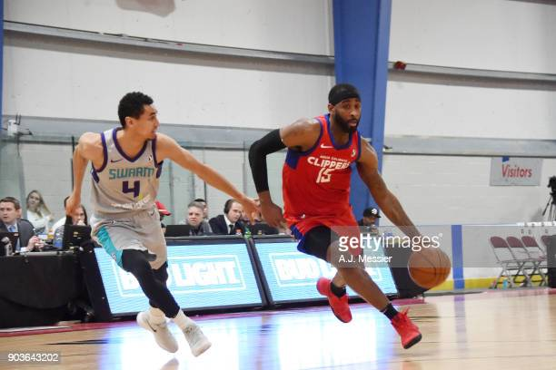 LaDontae Henton of the Agua Caliente Clippers handles the ball against Marcus Paige of the Greensboro Swarm during the NBA G League Showcase Game 4...