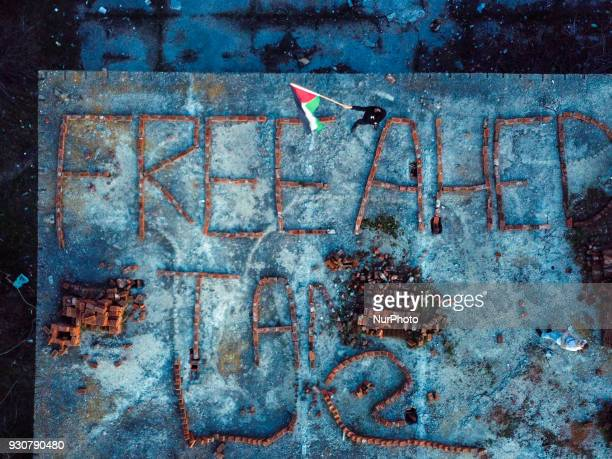 Ladraa wrote on the top of an old military barrack quotFREE AHED TAMquot by bricks which is about the the trial of Ahed Tamimi 16 years old girl She...
