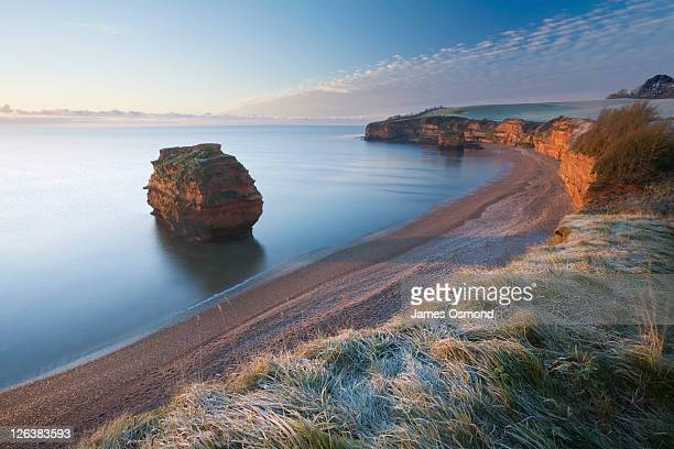 ladram bay at sunrise in winter. jurassic coast world heritage site. devon. england. uk. - coastline stock pictures, royalty-free photos & images