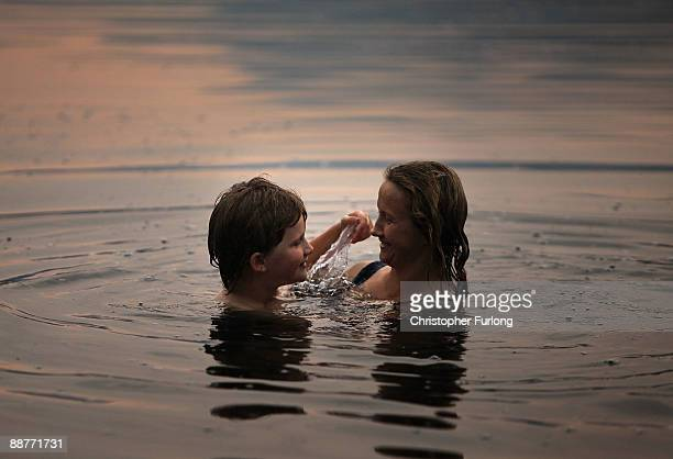 Lady Alice Douglas and her son Tybalt Melia aged nine swim at sunset in Llyn Mymbyr in the shadow of the Snowdon Horseshoe in North Wales on June 30...