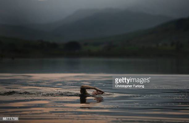 Lady Alice Douglas swims in Llyn Mymbyr at sunset in the shadow of the Snowdon Horseshoe in North Wales on June 30 2009 in Capel Curig United Kingdom...