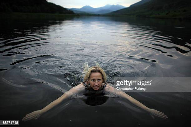 Lady Alice Douglas swims in Llyn Mymbyr in the shadow of the Snowdon Horseshoe in North Wales on June 30 2009 in Capel Curig United Kingdom Lady...