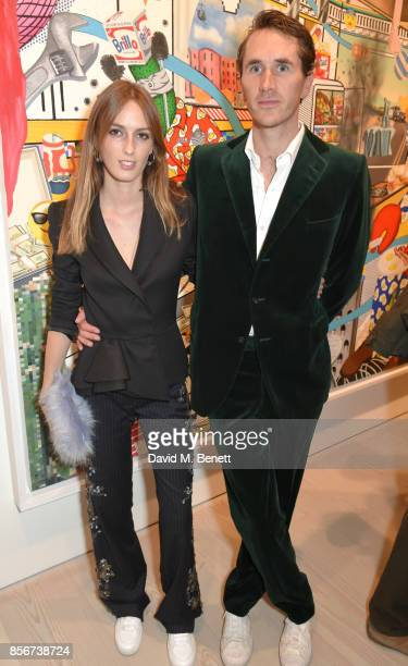 Lady Alice Manners and Otis Ferry attend a private view of Philip Colbert New Paintings at The Saatchi Gallery on October 2 2017 in London England