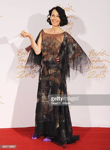Lady Amanda Harlech with the Isabella Blow Award for Fashion Creator poses in the winners room at the British Fashion Awards 2013 at London Coliseum...