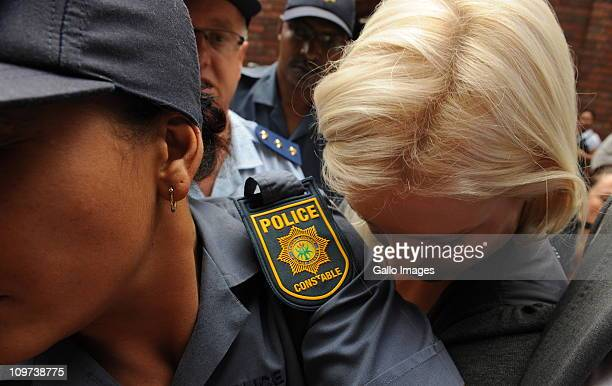 Lady Amelia Spencer is surrounded by police as she leaves the Cape Town Magistrates Court where she appeared on charges of common assault on March 3...