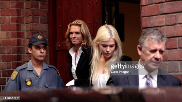 Lady Amelia Spencer leaves the Cape Town Magistrates Court with her lawyer William Booth and her mother Victoria Spencer and a police escort on April...