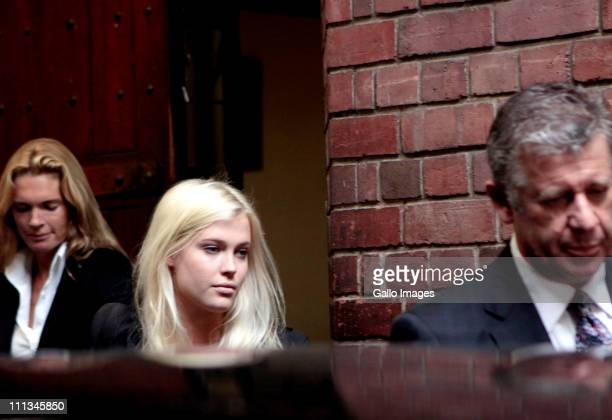Lady Amelia Spencer leaves the Cape Town Magistrates Court with her lawyer William Booth and her mother Victoria Spencer on April 1 2011 in Cape Town...