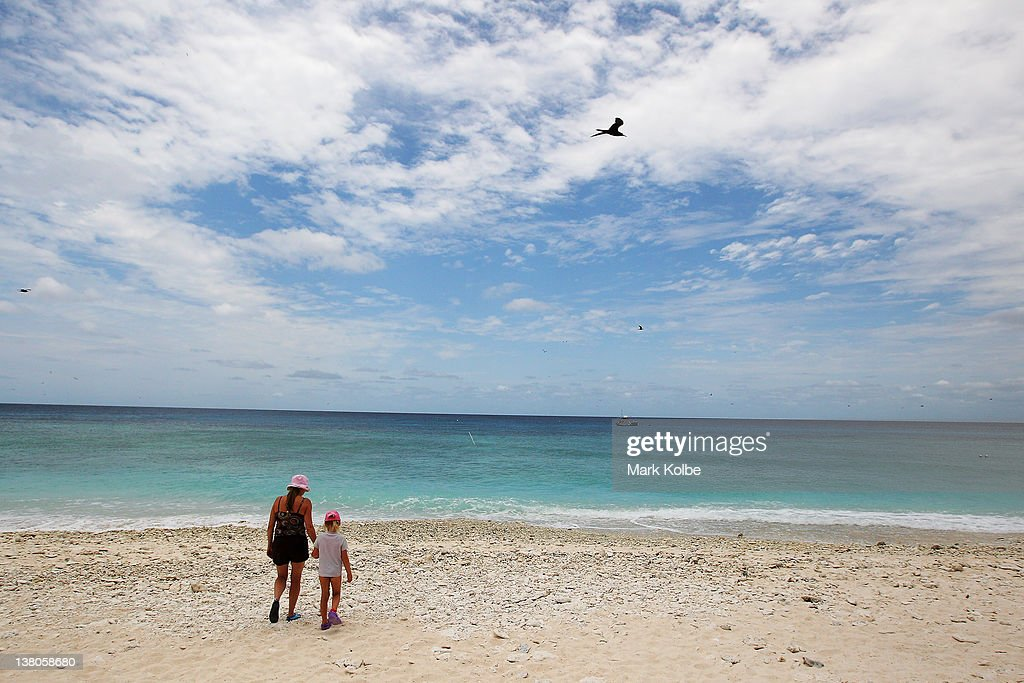 A lady and her daughter are seen as they walk to the water edge on a coral beach on January 14, 2012 on Lady Elliot Island, Australia. Lady Elliot Island is one of the three island resorts in the Great Barrier Reef Marine Park (GBRMPA) with the highest designated classification of Marine National Park Zone by GBRMPA. The island of approximately 40 hectares lies 46 nautical miles north-east of the Queensland town of Bundaberg and is the southern-most coral cay of the Great Barrier Reef.