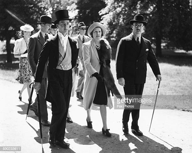 Lady and Lord Melchett with their son Derek Mond wearing formal dress attending the Fourth Day at Eton College England June 5th 1939